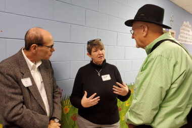 Cindy Corell (center) shares her eperiences in Haiti with attendees at the October 2019 presbytery meeting.