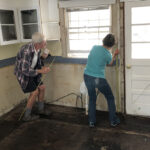 Once the kitchen is cleared of cabinets, Jeff and Betty Williams mark where to remove water-damaged drywall